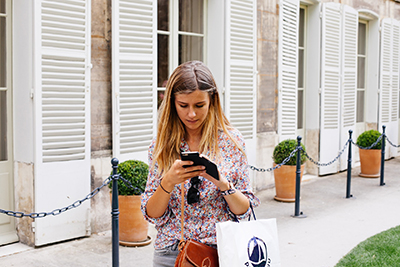 Girl purchasing a product from her smartphone.